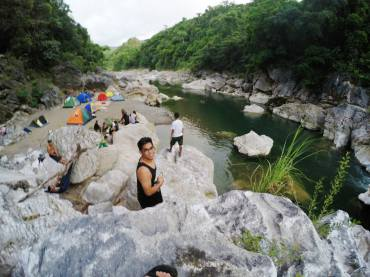 Our campsite at the far end and less 'challenging' to swim part of the river. Yes, most of us can't swim. Photo by Greisha Padilla.