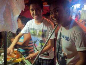 Gian and Jerome while enjoying the unlimited cheese powder at this fried potato stand