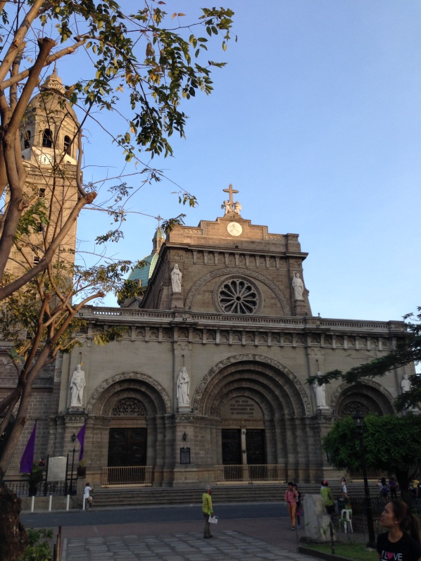 Facade of Manila Cathedral and the lighted emblem of the Papal insignia.