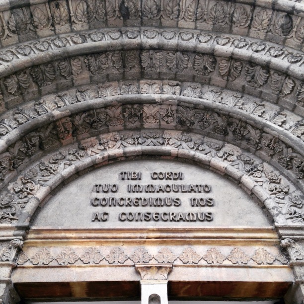 The façade (tympanum) of the cathedral bears a Latin inscription: Tibi cordi tuo immaculato concredimus nos ac consecramus (English: We consecrate to your immaculate heart and entrust to you (Mary) for safekeeping).