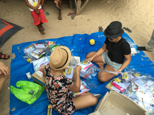 Team Jomalig preparing the school supplies for the outreach event.
