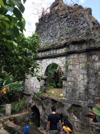 The coral stone arch that stands on top of the 11ft deep miraculous well of Sta. Lucia.